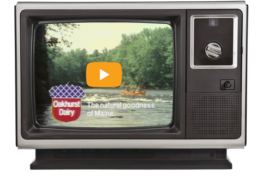 https://www.oakhurstdairy.com/wp-content/uploads/2021/02/milestone-1970-canoeing-VIDEO@2x.png